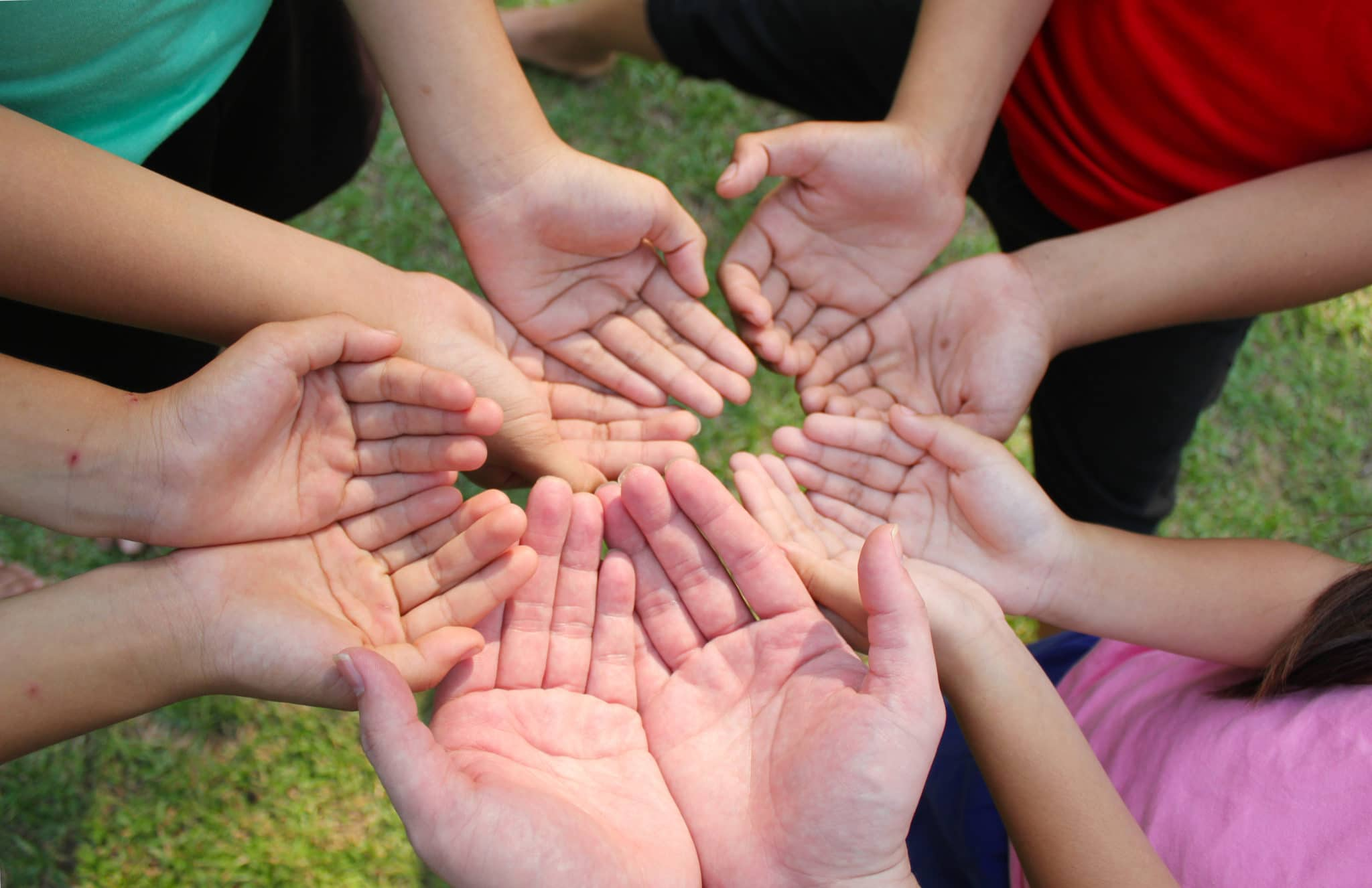 Group-holding-giving-hands